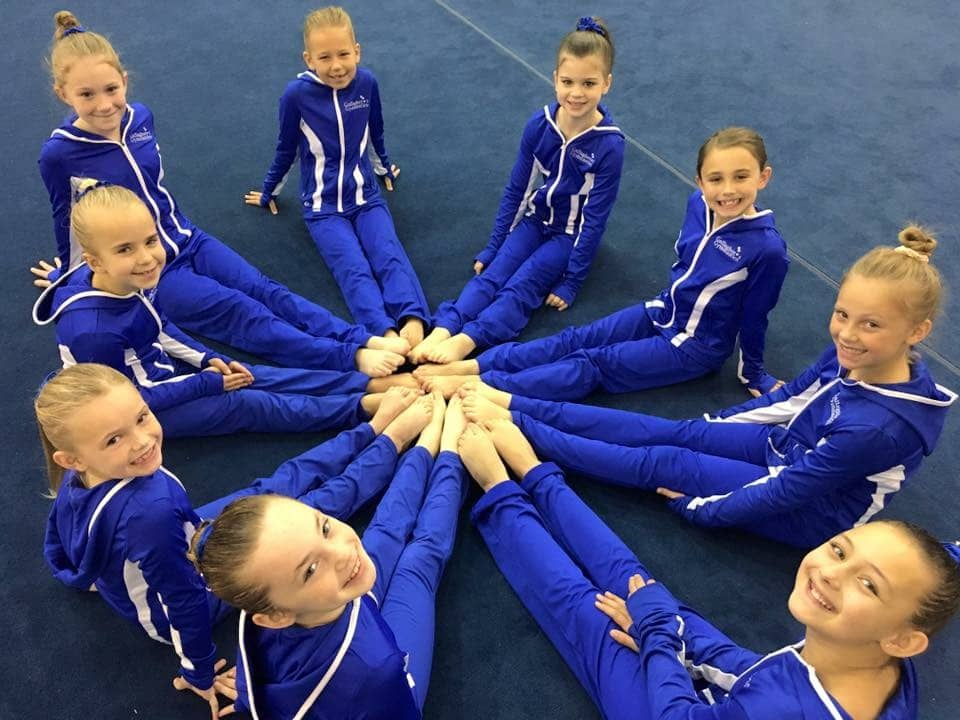 Girl Gymnasts in a circle